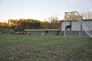 Patrick Frick dives to save the shot from Christchurch's #4 (Photo Credit: Jennifer Cole)
