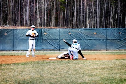 Charlie Dillon attempts to avoid the tag on a slide (Photo by: Paul Fritschner)