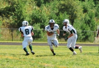 Juniors Michael Horan, Michael Foster, and Brandon Perroots run a play (Photo by: Laurie Young)