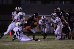 John Paul's defense wraps up the ball carrier (Photo by: Liz Magyar)