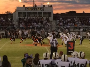 The sun sets in the distance as the game gets underway (Photo by: Paul Fritschner)