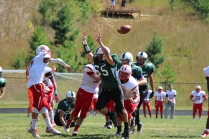 The Wolves put pressure on the opposing QB as he throws the ball (Photo by: Liz Magyar)