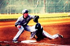 Nic Jenkins (Class of 2013) slides into third base (Photo by: Paul Fritschner)