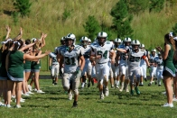 The Wolves celebrate after their first win of the season over The Potomac School (Photo by: Laurie Young)